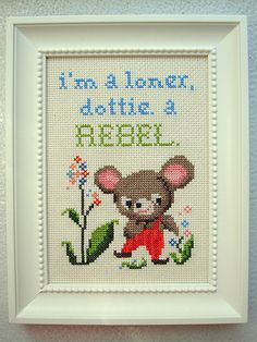 """I'm a loner, dottie. A rebel."" - Pee Wee Herman, ""Pee-Wee's Big Adventure."" Framed cross stitch."