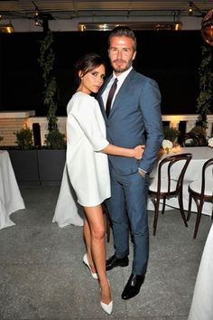 Victoria Beckham in a white mini dress + white heels