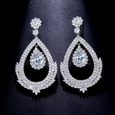 Art Deco CZ Dangle Earrings, Teardrop Earrings. This beautiful art deco dangle earrings is individually handcrafted with sparkling cubic zirconia diamond pave setting. We use top grade AAA swiss-made CZ, the drop earring is eco-friendly and does not contain lead, nickel or cadmium. It features high quality white gold rhodium plated for tarnish resistance and a long lasting mirror finish.