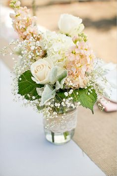 137 Creative Things You Didn't Know You Could Do With Mason Jars. Transparent jars are wonderful if you're using flowers in pastel and light shades. In this case, the jar was also decorated with lace.