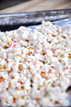 peppermint popcorn bark  ~Melt one entire package (16 oz.) of vanilla flavored almond bark. Stir in a popped bag of popcorn (I like salted), picked free of any kernels, 6 crushed candy canes and 1/2 t. peppermint extract.