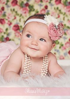 www.iliasismunizphotography.com baby girl photos, vintage baby photos, pink tutu with pearls, baby blue eyes.