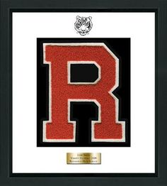 Ridgefield High School in Connecticut Varsity Letter Frame - Showcase your varsity letter in our Omega solid hardwood shadowbox frame in black satin finish with hand embossed tiger logo, on our white and black museum quality matting. A personalized engraved plate is included.