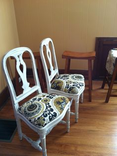 Ikea Gustavian Swedish Chairs circa 1995, that I recovered in a heavy mid century print fabric. i have 4 of these in the dining room.