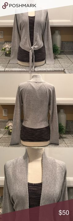 Athleta Front Tie Sweater Beautiful Athleta light gray front tie sweater. Wear it for your physical workout or on your casual day with your favorite jeans. In excellent like new condition. 😊 Athleta Sweaters