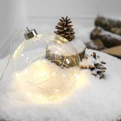 Battery glass ball light with 20 warm white LEDs on silver wire. With a handy timer function, this light suits any interior décor and window displays. Christmas Lights, Christmas Ornaments, Ball Lights, Glass Ball, Christmas Pictures, Wire, Display, Holiday Decor, Silver