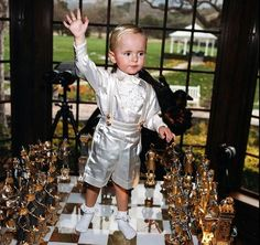 Prince (age 3) plays chess with his dad at their home Neverland in 2000.