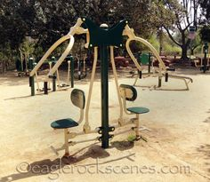 Next to the children's playground, there is an adult playground full of outdoor exercise equipment.