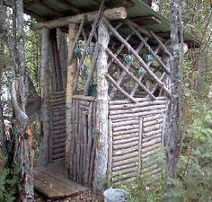 outhouse...upper walls can be used to hold wine bottles, it would be worth the trip....lol