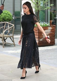 Finishing touches:Conventional black stiletto heels completed the look as Victoria hurrie...
