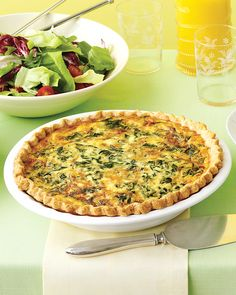 This outstanding quiche relies only on a few simple elements: a creamy egg custard, buttery homemade crust, and flavorful Gruyere cheese and spinach. This quiche will be a standout at your Mother's Day brunch. Spinach Quiche, Quiche Recipes, Brunch Recipes, Gruyere Cheese, Cheese Quiche, Brunch Ideas, Frittata, Yummy Quiche, Side Dishes