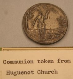 John Calvin and the Presbyterian Church sought to remove irregularities found in the observance of the Lord's Supper and saw the usefulness of tokens to do so. These 'tokens' were often made of lead and were distributed to congregation members, by the church elders, in the days just prior to the Communion Service. Without a token a person would not be allowed to participate in communion. This is one such token from the Huguenot Church.