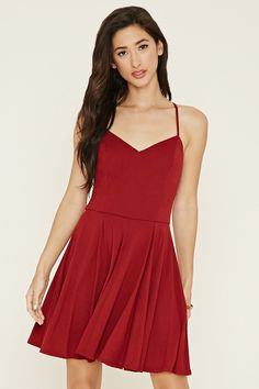 Forever 21 Crisscross Cami Mini Dress $15 : A knit mini dress with a V-neckline, adjustable cami straps that crisscross in back, and a skater silhouette.