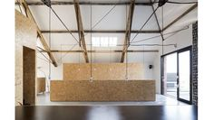 Ochre Barn by Carl Turner Architects. Great use of industrial lighting in an old industrial/rustic but beautiful space.