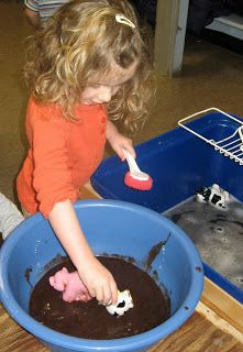 """LITERATURE 1 Miss Wishy Washy: The students have just read a book called """"Miss Wishy Washy"""" (a summary is available through a link on the page).  The teacher sets up a center with """"mud"""" where the students get the animals dirty and then clean them with soap and water.  This is an extension from the book because the students are taking the idea of washing the animals clean and physically doing it."""