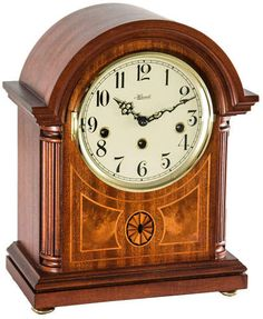 The Clearbrook Mahogany Mechanical Hermle Mantel Clock is designed in an elegant barrister style along with a rich mahogany finish. This piece is finished with fluted columns, exquisite inlaid marquetry, ivory dial and Arabic numerals. Wooden Columns, Fluted Columns, Tabletop Clocks, Mantel Clocks, Clock Decor, Wall Clocks, Westminster, Radios, Howard Miller