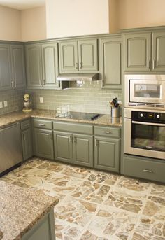 """Cabinet Paint Color: Sherwin Williams' """"Thunderous"""". ProMar 200 line, satin finish. (Actually gray with green undertones)  gray-green cabinets, not sure if i like them"""