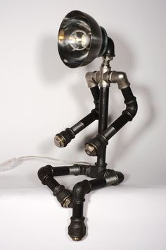 Pipeman Lamp made from metal pipe (upcycled to an electric light) #woodandroot #Contemporary