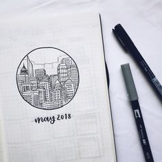 Bullet journal monthly cover page, May cover page, city drawing, buildings drawing, hand lettering. | @cup_doodles
