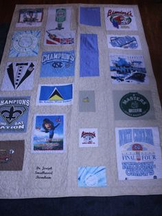 This memory quilt was made from just a few t shirts and scrubs from a father who passed away. This quilt is a throw size . She only had a few shirts to use. I always try to pick the most interesting things on the t shirts. Of course because of this you end up with different size squares and I try to arrange them in the best possible way. This quilt was also embroidered with the father's name. If you would like one of these quilts made for you please contact me and after we agree on how you…