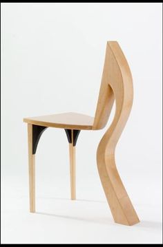 cleft chair.  maple, wenge. I want to start a pinterest inspired collection of weird chairs.