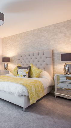How delicate and peaceful this grey and yellow bedroom decor looks? High end furniture, glamorous mirrored drawers chest elegant bed tile and fluffy bed rug!