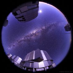 A Milky Way Dawn . As dawn broke on March 27, the center of the Milky Way Galaxy stood almost directly above the European Southern Observatory's Paranal Observatory. In the dry, clear sky of Chile's Atacama desert, our galaxy's dusty central bulge is flanked by Paranal's four 8 meter Very Large Telescope units in this astronomical fisheye view.... Image Credit & Copyright: Babak Tafreshi (TWAN), ESO Ultra HD Expedition