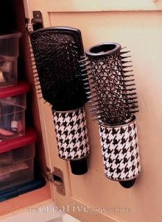 Cover tin cans with fabric and attach them to the inside of the bathroom vanity to hold brushes or your curling iron.