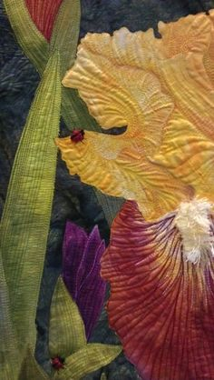 IMAG2067~~the detail in this quilt!!! The quilting on the iris falls makes it look just like a realistic  iris fall!!!