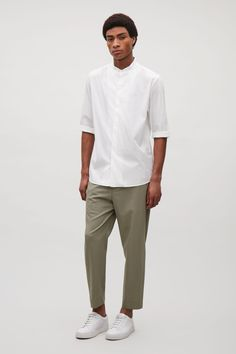 This shirt is made from soft, lightweight cotton-blend with neatly folded grandad collar. A casual style, it has folded sleeves, a graduating hemline and hidden front buttons with visible bartacks between. Cos Stores, Cos Shirt, Grandad Shirts, How To Fold Sleeves, Latest Clothes For Men, Mens Fashion, Fashion Outfits, Manga, Minimalist Fashion