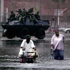 Michael Ainsworth 2006 Pulitzer Prize (Breaking News Photography) - New Orleans, LA -- Tossed together by crisis, 81-year-old Louis Jones (left) and 62-year-old Catherine McZeal join forces to navigate Poydras Street in their trek to the Superdome and a chance at evacuation.