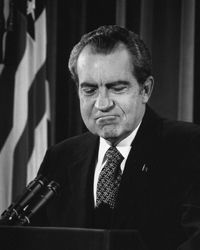 Which is a better topic question for a history essay on Watergate?