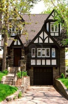 Residential tudor style house with green trees Stock Photo