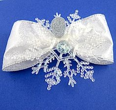 There is no craft angel more beautiful than this snowflake angel. You can make an amazing handmade Christmas decoration, gift topper, or homemade Christmas ornament in a few easy steps. It'll look beautiful in the light.