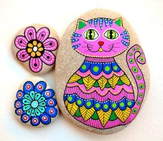 Hand Painted Stone Cat Beach pebble with hand-painted designs in acrylics © Sehnaz Bac 2016 I paint and draw all of my original designs by hand with the small brushes or paint pens with extra fine tip. I use also isographs with different inks. No stencils are used. All designs are created with my imagination. These pebbles were found on the beaches of Adriatic Sea. Each was chosen for its shape, smoothness and uniformity. They are protected with 2 or 3 layers of high quality glossy acrylic…