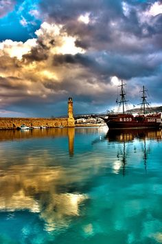 Ugh my favorite place on earth! I miss Crete! Best people and food in the world! Lighthouse at Chania, Crete island, Greece