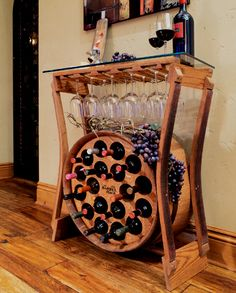 The Wine Bar holds 18 bottles of wine, storage for 15 stems, and a glass top for serving or decor.  $1185 https://www.barrelrack.com/products