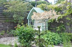 A beautiful painted arbour tucked away in a secluded corner.