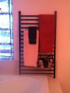 Towel rack made from old crib rail. upcycled crib