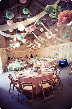 pink and mint paper pom poms barn wedding reception decor / http://www.himisspuff.com/pom-poms-decor-ideas-for-your-wedding/3/