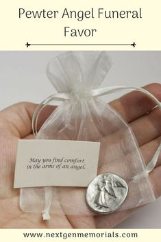 "Pewter Angel Funeral Favor, The enclosed card says, ""May you find comfort in the arms of an angel."" Friends and family will remember your loved one everytime they come across the angel funeral favor.  #funeralfavor, #memorialgift, #pewterangel, #Mom, #funeral, #idea"