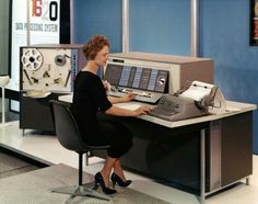 Woman working with an early IBM data processing  system 1958