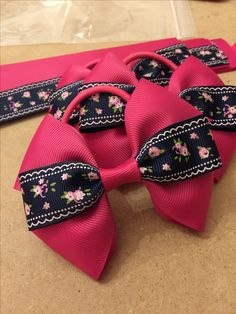 Cerise pink and navy blue floral grosgrain ribbon hair bows on thick bobbles - www.dreambows.co.uk