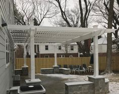 Winter wonderland work in progress Vinyl Pergola by As You Like It Landscaping in Maryland! Can't wait to see the finished product, looks great already! Made with FLEX•fence.