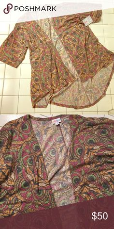 LuLaRoe S NWT Lindsay HTF owl head print open hi-lo cardigan.  This is like a soft t-shirt material and not thicker like most. LuLaRoe Sweaters Cardigans