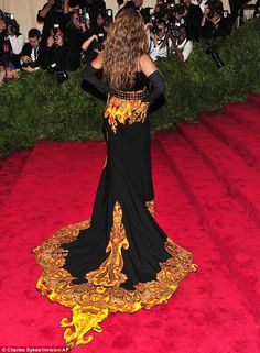 2013 met gala.    Beyonce.  Back it up: The gown's train was impressive and flame-like, but the studded belt looked thrown on at the last minute.  Givenchy