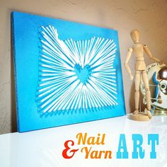 This DIY nail and yarn heart art is a beautiful alternative to a ...