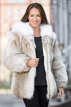 Fashioned in American coyote fur for a dramatic presentation, our stunning…