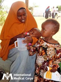 May 7: A mother feeds her child Plumpy'Nut, a peanut-based nutrition supplement.   Photo: Alexandra Rutishauser-Perera, International Medical Corps, Kenya 2012