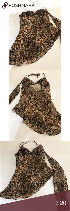 Cheetah Print Top Cheetah Print sexy top. Cute paired with jeans or black leather tights. Super fun top! Great condition. No signs of wear. No stains, marks, or tears. Tops Blouses